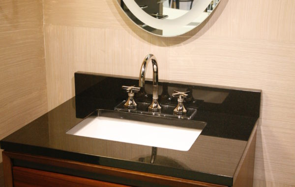 Black Stone Counter with White Porcelain Sink